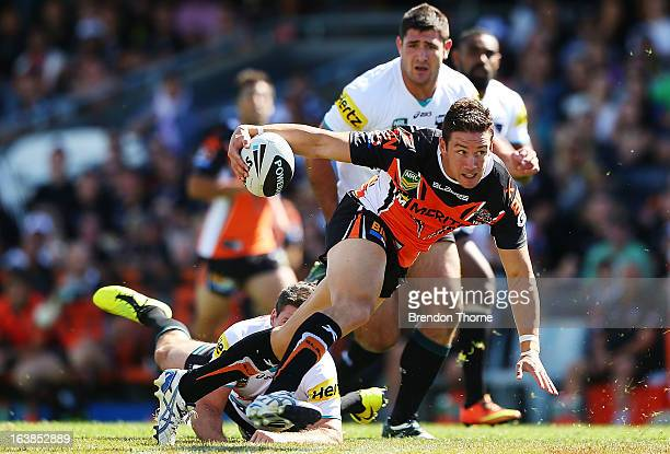 Tim Moltzen of the Tigers breaks the Panthers defence during the round two NRL match between the Wests Tigers and the Penrith Panthers at...