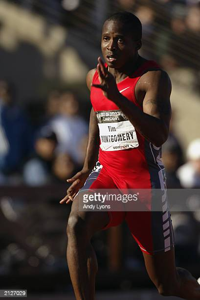 Tim Montgomery competes in the men's 100m semi-finals prelims at the USA Outdoor Track and Field Championships on June 20, 2003 at Cobb Track and...