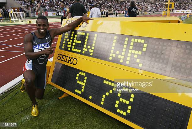 Tim Montgomery of the USA celebrates a new world record of 978 seconds after the Men's 100 metres at the 18th IAAF Grand Prix Final held at the Stade...