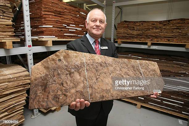 Tim Morris shows off hard wood veneers that can be personally chosen by customers at the Bentley Motors Factory on 19 November 2007 in Crewe England...