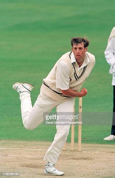 Tim Munton bowling for Warwickshire circa May 1995