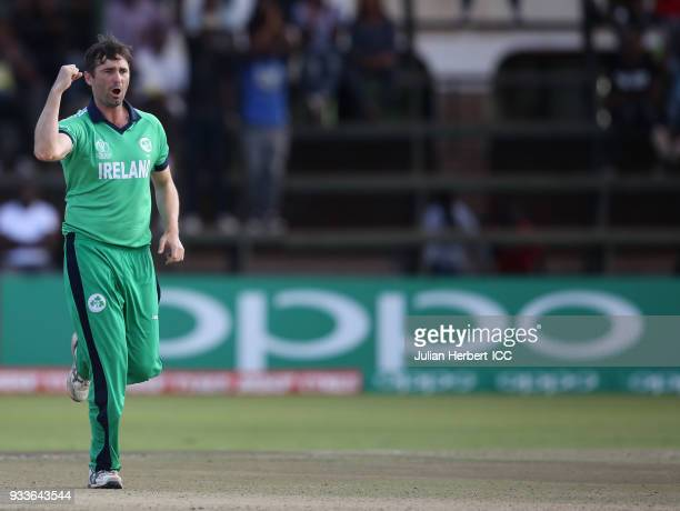 Tim Murtagh of Ireland celebrates the wicket of Richie Berrington of Scotland during The Cricket World Cup Qualifier between Ireland and Scotland at...