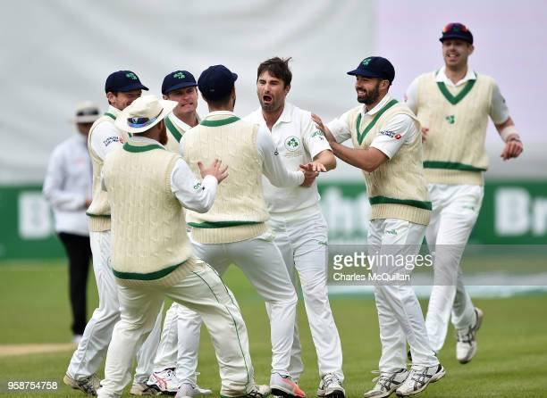 Tim Murtagh of Ireland celebrates with team mates after taking the wicket of Asad Shafiq of Pakistan during the fifth day of the international test...
