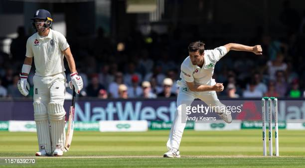 Tim Murtagh of Ireland in delivery stride as Rory Burns of England looks on during day two of the Specsavers 1st Test match between England and...