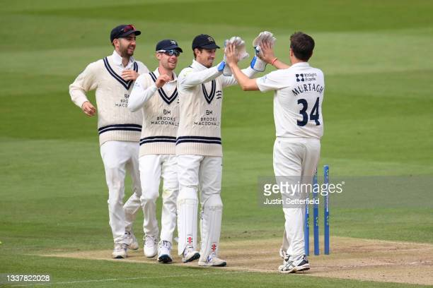 Tim Murtagh of Middlesex celebrates with John Simpson of Middlesex after taking the wicket of Leus du Plooy of Derbyshire during Day four of the LV=...