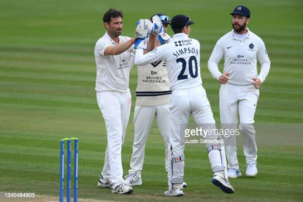 Tim Murtagh of Middlesex celebrates with John Simpson of Middlesex after taking the wicket of Daryl Mitchell of Worcestershire during the LV=...