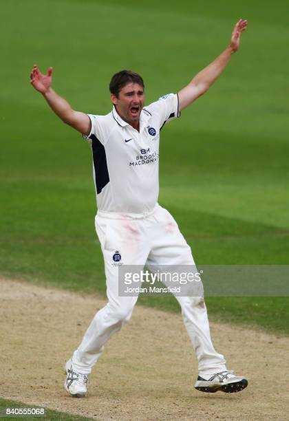 Tim Murtagh of Surrey celebrates dismissing Ollie Pope of Surrey during day two of the Specsavers County Championship Division One match between...