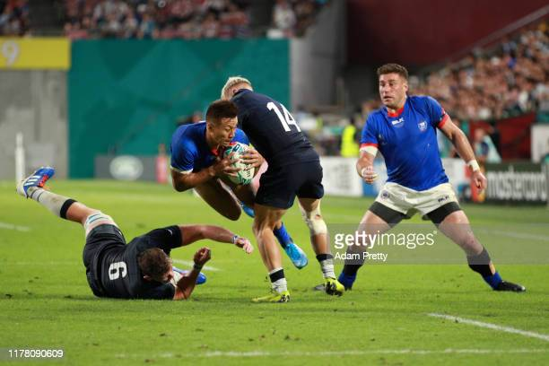 Tim Nanai-Williams of Samoa is tackled by Darcy Graham and Magnus Bradbury of Scotland during the Rugby World Cup 2019 Group A game between Scotland...