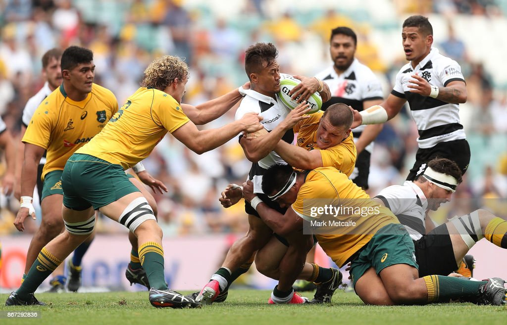Tim Nanai-Williams of the Barbarians is tackled during the match between the Australian Wallabies and the Barbarians at Allianz Stadium on October 28, 2017 in Sydney, Australia.