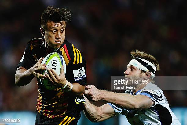 Tim NanaiWilliams of the Chiefs makes a break during the round 11 Super Rugby match between the Chiefs and the Force at Waikato Stadium on April 24...