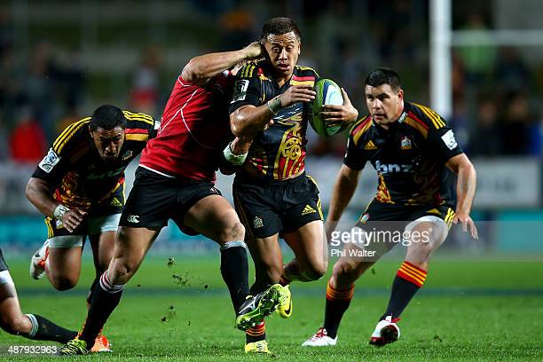 Tim NanaiWilliams of the Chiefs makes a break during the round 12 Super Rugby match between the Chiefs and the Lions at Waikato Stadium on May 3 2014...