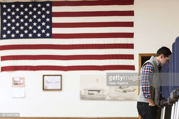 Tim Nicholson casts a vote in the South Carolina Republican presidential primary at American Legion Post 79 on February 20 2016 in West Columbia...