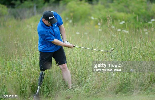 Tim Niles of Brewer chips out of tall grass on the 16th hole during the secondannual Maine Amputee Golf Tournament in Falmouth Wednesday July 25 2018...