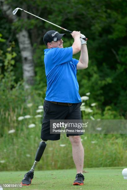 Tim Niles of Brewer tees off on the 16th hole during the secondannual Maine Amputee Golf Tournament in Falmouth Wednesday July 25 2018 Niles lost his...