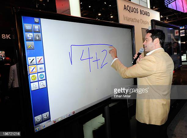 Tim Noonan demonstrates a Sharp Aquos Interactive Display System prototype on a 1080p fullHD 70inch LED/LCD display at the Sharp Electronics booth at...