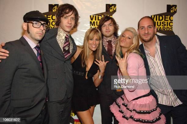 Tim Nordwind Damian Kulash Andy Ross and Dan Konopka of Ok Go with Lilian Garcia and Ashley