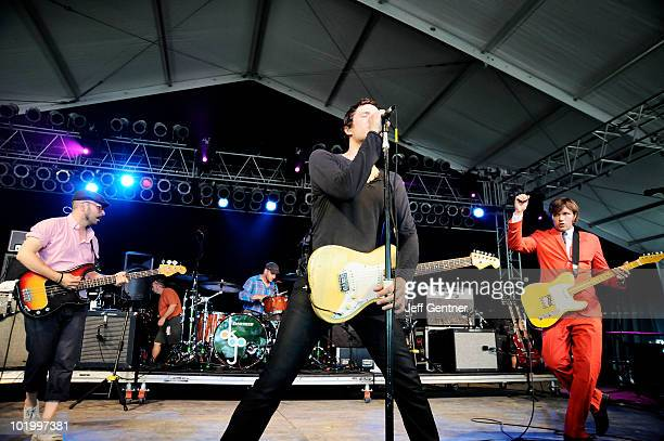 Tim Norwood Dan Konopka Damian Kulash and Andy Ross of OK Go perform during the 2010 Bonnaroo Music and Arts Festival Day 2 on June 11 2010 in...