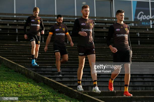 Tim O'Brien and Tom Mitchell of the Hawks arrive during a Hawthorn Hawks AFL Training Session at Waverley Park on June 17, 2020 in Melbourne,...