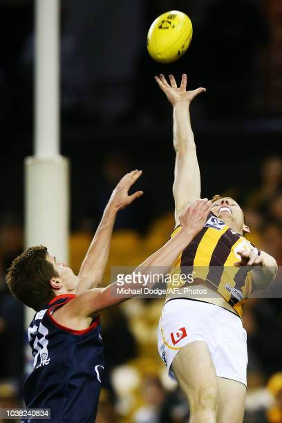 Tim O'Brien of the Box Hill Hawks competes for the ball against Bayley Fritsch of the Demons during the VFL Grand Final match between Casey and Box...
