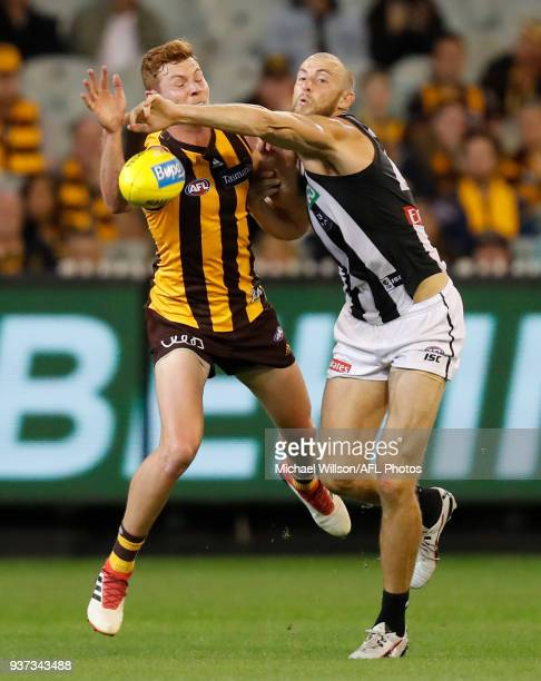 Tim O'Brien of the Hawks and Ben Reid of the Magpies in action during the 2018 AFL round 01 match between the Hawthorn Hawks and the Collingwood...