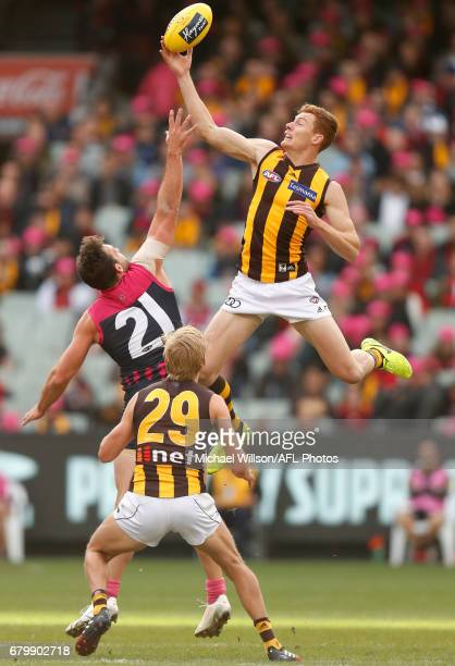 Tim O'Brien of the Hawks and Cameron Pedersen of the Demons compete in a ruck contest during the 2017 AFL round 07 match between the Melbourne Demons...