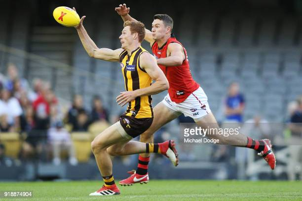 Tim O'Brien of the Hawks gathers the ball from Conor McKenna of the Bombers during the AFLX match between Hawthorn Hawks and Eseendon Bombers at...