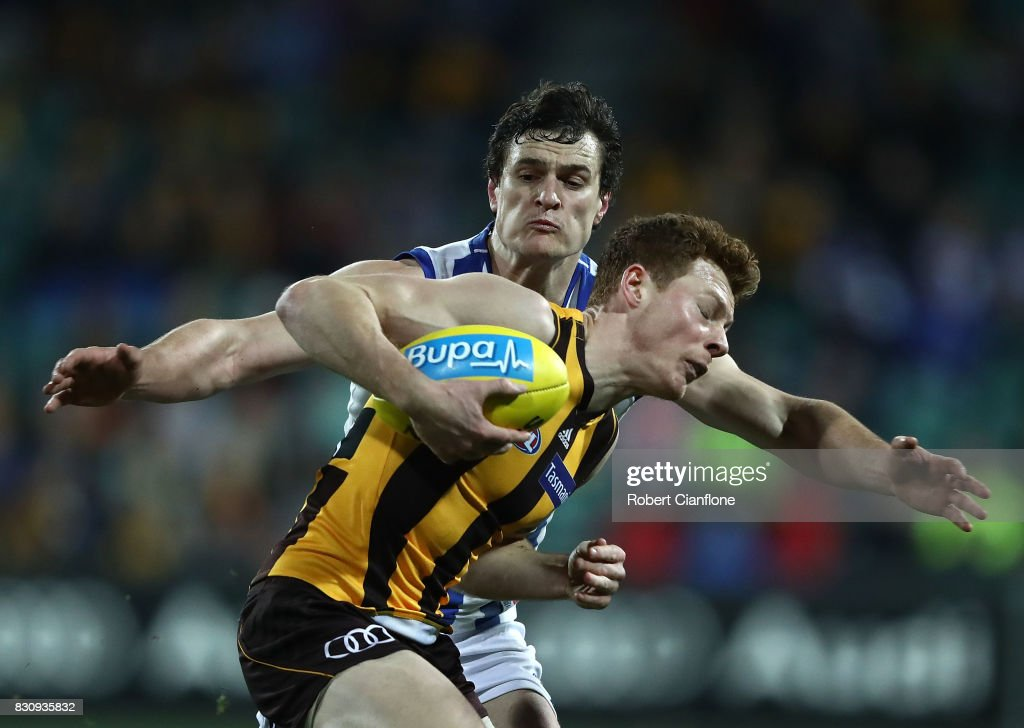 Tim O'Brien of the Hawks is challenged by Scott Thompson of the Kangaroos during the round 21 AFL match between the Hawthorn Hawks and the North Melbourne Kangaroos at University of Tasmania Stadium on August 13, 2017 in Launceston, Australia.