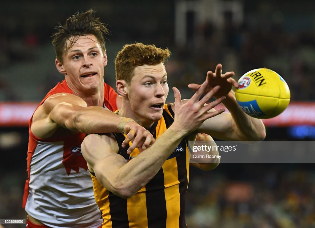 Tim O'Brien of the Hawks marks infront of Callum Sinclair of the Swans during the round 19 AFL match between the Hawthorn Hawks and the Sydney Swans at Melbourne Cricket Ground on July 28, 2017 in Melbourne, Australia.