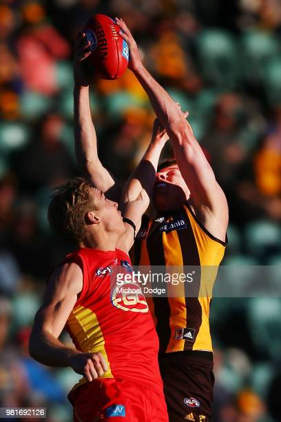 Tim O'Brien of the Hawks marks the ball against Tom Lynch of the Suns during the round 14 AFL match between the Hawthorn Hawks and the Gold Coast...