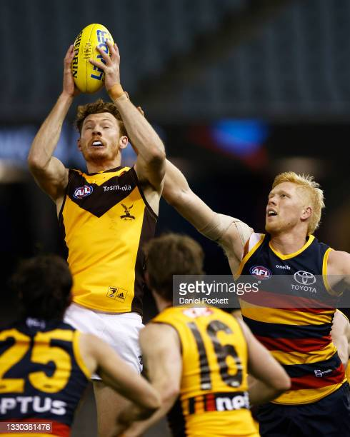 Tim O'Brien of the Hawks marks the ball during the round 20 AFL match between Adelaide Crows and Hawthorn Hawks at Marvel Stadium on July 24, 2021 in...