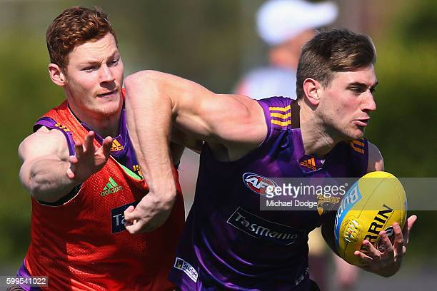 Tim O'Brien of the Hawks tackles Ryan Schoenmakers during a Hawthorn Hawks AFL training session at Waverley Park on September 6 2016 in Melbourne...