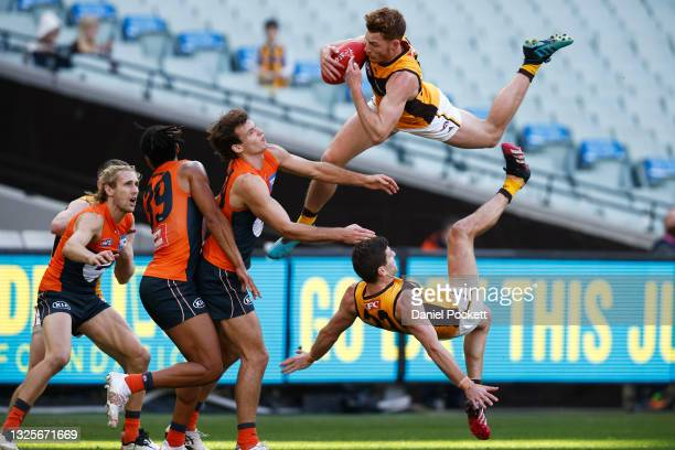 Tim O'Brien of the Hawks takes a spectacular mark during the round 15 AFL match between the Greater Western Sydney Giants and the Hawthorn Hawks at...