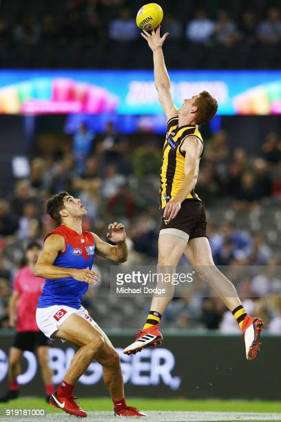 Tim O'Brien of the Hawks taps the ball over Christian Petracca of the Demons during the AFLX match between Hawthorn Hawks and Melbourne Demons at...