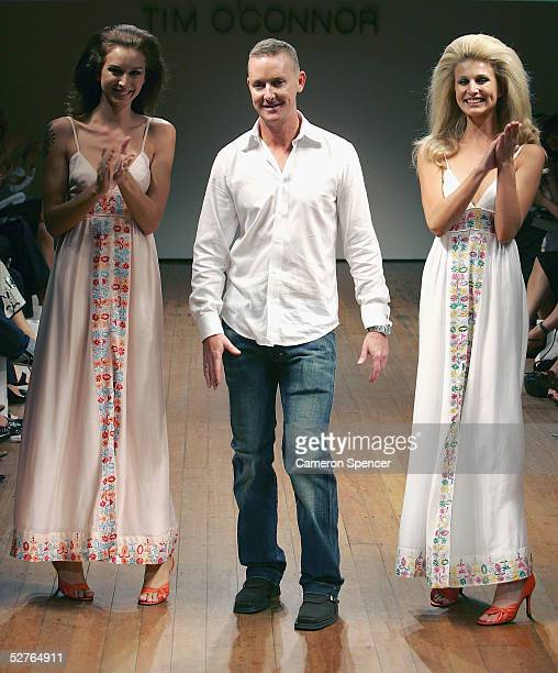 Tim O'Connor is acklnowledged by the crowd and models on the runway at the Tim O Connor collection presentation at the Billich Gallery during the...