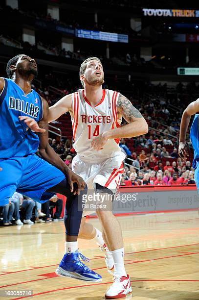 Tim Ohlbrecht of the Houston Rockets battles for positioning against Bernard James of the Dallas Mavericks on March 3 2013 at the Toyota Center in...