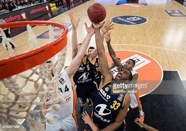 Tim Ohlbrecht of Ulm Niels Giffey of Berlin and Jamel McLean of Berlin jump for a rebound during the Beko Basketball Bundesliga match between...
