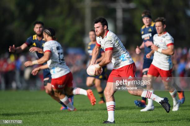 Tim O'Malley of the Crusaders looks to pass the ball during the Farmlands Cup pre-season Super Rugby Aotearoa match between the Crusaders and the...