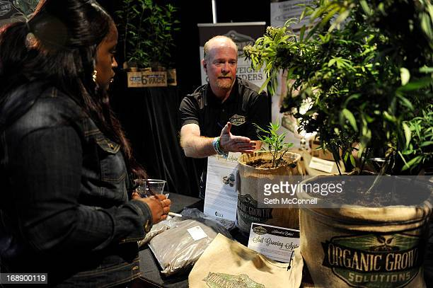 Tim O'Mara of Organic Grower Solutions tells a potential customer about the companies product an organic nutrient rich soil during the High Times US...