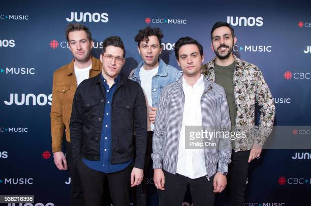Tim Oxford Anthony Carone Max Kerman Mike DeAngelis and Nick Dika from the Arkells attend the red carpet arrivals at the 2018 Juno Awards at Rogers...