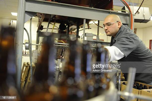 Tim Padilla works bottles along a conveyor belt on Wednesday December 1 2010 at the Breckenridge Brewery Wynkoop Brewing Company will begin producing...