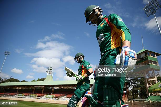 Tim Paine and Ben Dunk of the Tigers walk out to bat during the Matador BBQs One Day Cup match between Victoria and Tasmania at North Sydney Oval on...
