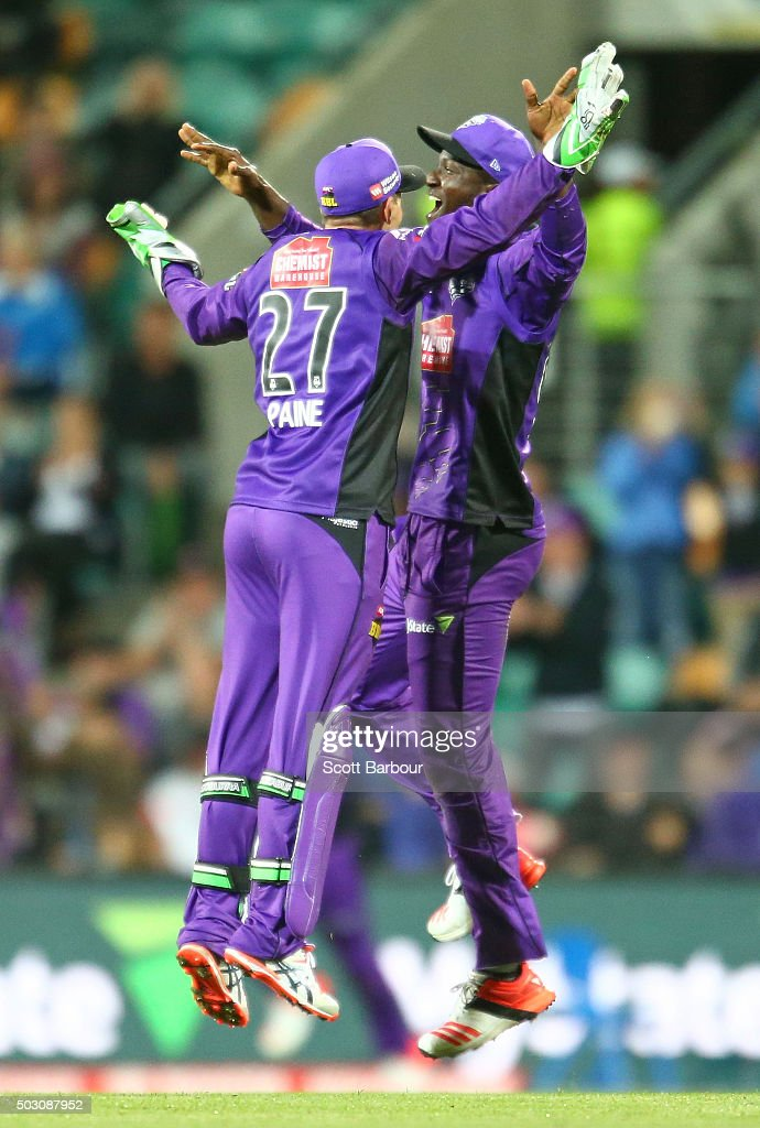 Tim Paine and Darren Sammy of the Hurricanes celebrate as they win the Big Bash League match between the Hobart Hurricanes and the Sydney Thunder at Blundstone Arena on January 1, 2016 in Hobart, Australia.
