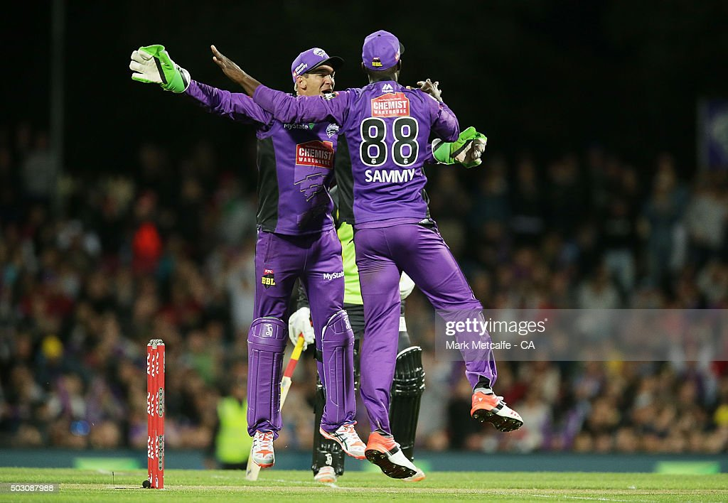 Tim Paine and Darren Sammy of the Hurricanes celebrate victory in the Big Bash League match between the Hobart Hurricanes and the Sydney Thunder at Blundstone Arena on January 1, 2016 in Hobart, Australia.