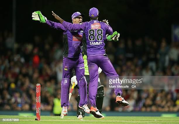 Tim Paine and Darren Sammy of the Hurricanes celebrate victory in the Big Bash League match between the Hobart Hurricanes and the Sydney Thunder at...