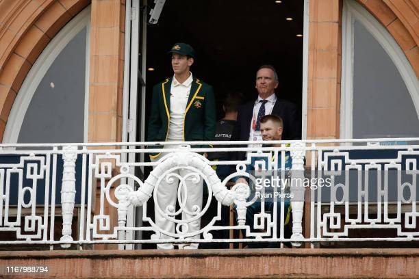 Tim Paine and David Warner of Australia and Australian Chairman of Selectors Trevor Hohns look on as rain delays the start of play during the...