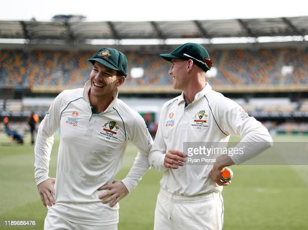 Tim Paine and Marnus Labuschagne of Australia celebrates victory during day four of the 1st Domain Test between Australia and Pakistan at The Gabba...