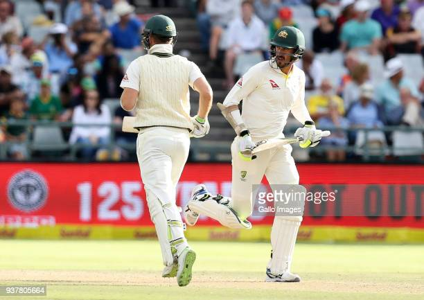 Tim Paine and Mitchell Starc runs between the wickets during day 4 of the 3rd Sunfoil Test match between South Africa and Australia at PPC Newlands...