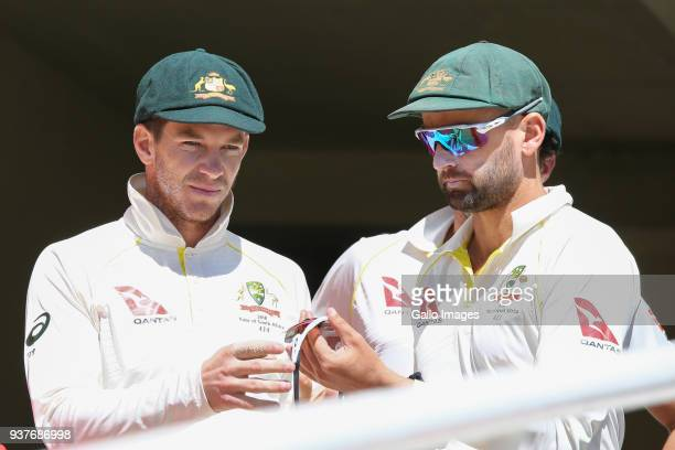 Tim Paine and Nathan Lyon from Australia during day 4 of the 3rd Sunfoil Test match between South Africa and Australia at PPC Newlands on March 25...