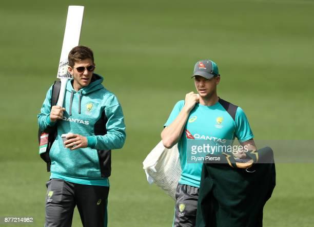 Tim Paine and Steve Smith of Australia arrive during an Australian nets session at The Gabba on November 22 2017 in Brisbane Australia