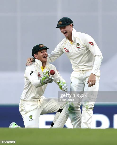 Tim Paine and Steve Smith of Australia field the ball during day one of the First Test Match of the 2017/18 Ashes Series between Australia and...